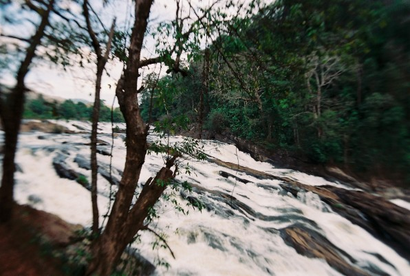 The Chalakudy river cascading past the Forest Rest House