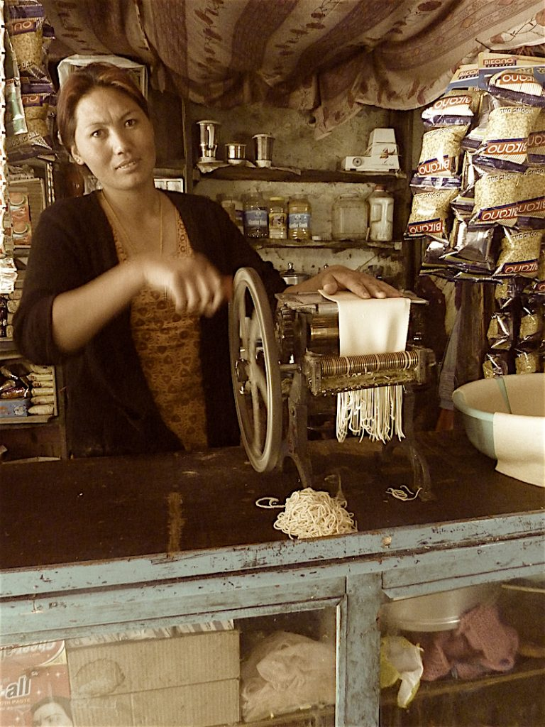 Lady in Rawat's eatery making noodles for thukpa.